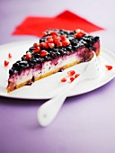 Slice of fromage blanc, blackcurrants and pomegranate seeds