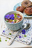 Chocolate mousse with almonds, hazelnuts, pansies and mint