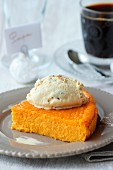 Slice of pumpkin pie topped with a scoop of exotic fruit ice cream