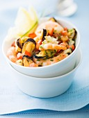 Mixed shrimps, mussels and diced tomatoes with chopped parsley