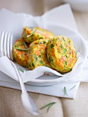 Yellow and green courgette, pea and carrot patties
