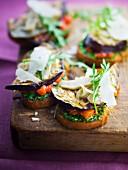 Pesto, diced tomato, grilled eggplant, artichoke, parmesan and rocket lettuce Italian open sandwiches