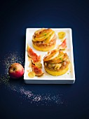 Mini potato gratins with slices of apple and compote, figs and raisins