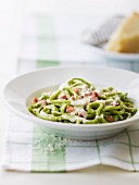 Spinach pasta in creamy parmesan and thinly diced ham sauce