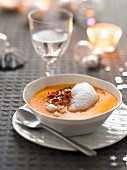 Cream of pumpkin soup with crisp bacon and maple syrup espuma