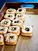 Leavened donuts with blackcurrant jam center and Crosstown peanut butter frosting