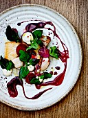 Pan-fried squid with old-fashioned vegetables and beetroot juice