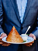 Duck braised with Chettinad masala under a lentil galette cone and coconut chutney