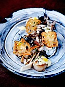 Lotus crisps with roasted scallops, pan-fried shimeji mushrooms and truffle Béarnaise