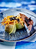 Duck magret and cabbage makis, balsamic and blueberry condiment, thinly sliced carrots and rice tuile