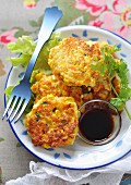 Asian-style pumpkin, sweetcorn and tofu fritters