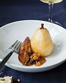 Poached pear with pan-fried foie gras and chestnut in sauce