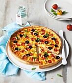 Red and yellow cherry tomato pizza
