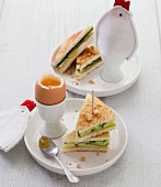 Soft-boiled egg , potato, cucumber and crushed peanut club sandwiches