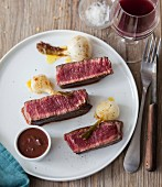 Grilled beef fillet, preserved spring onions, red wine sauce