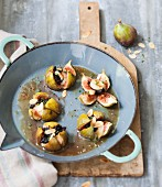 Roasted figs with scallops, tapenade and thinly sliced almonds