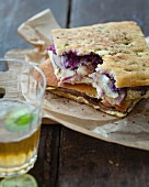 Leg of lamb, pickled red cabbage, onion petals and oyster mayonnaise focaccia sandwich
