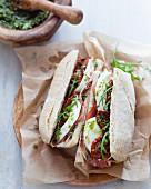 Mozzarella, marinated tomatoes, almond and rocket lettuce Spalla di Palasone panini