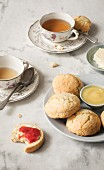 Afternoon tea with scones, butter, strawberry jam and lemon curd