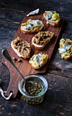 Caper tapenade crostinis and grilled leek fondue and gorgonzola crostinis
