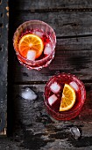Glasses of Sprits and Negroni
