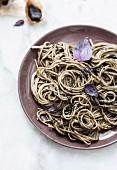 Soba noodles with purple basil, black sesame and black garlic black pistou