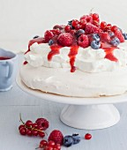 Mixed summer berry Pavlova with strawberry coulis