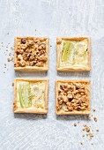 Square leek tartlets with crushed hazelnuts