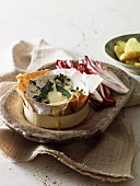 Baked camembert with thyme and bay leaves
