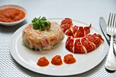 Small lobster pastilla with tomato coulis