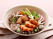 Quinoa salad with shrimps, smoked bacon, carrots, radishes and wild asparagus