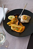 Cod fillet with spring vegetables, sweet potato mash and parsnips