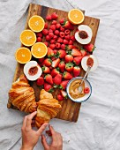 Breakfast with croissants and fresh fruit