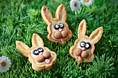Small rabbit Easter tartlets in the grass
