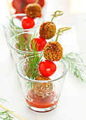 Cherry tomato and quinoa croquette brochettes, tomato coulis