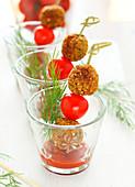 Cherry tomato and quinoa croquette brochettes, tomato coulis
