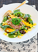Asian-style noodle, mango and green seaweed salad