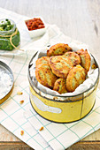 Parmesan and sun-dried tomato shortbreads,carrot top pesto in a metal box