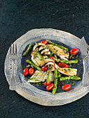 Grilled squid with asparagus and small tomatoes