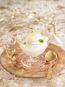 Yoghurt cream with lemon sorbet and mint flakes