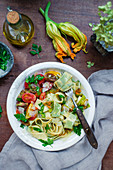 Homemade herb stuff pasta with zucchini and zucchini blossoms