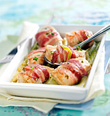 Chicken bites wrapped in bacon with leeks