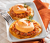 Potato pancakes with tuna and red pepper whipped cream