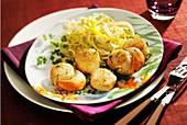 Scallops with parsley butter, spaghettis and thinly sliced leeks