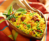 Spanish rice with turmeric,chorizo, tomatoes, peas and sage
