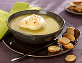 Cream of split pea soup with spicy hot whipped cream