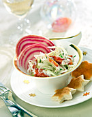 White cabbage,crab and thinly sliced chioggia beetroot salad
