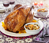 Turkey roasted with honey and orange, vegetable and dried fruit cassolette