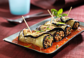Eggplant rolls garnished with ground beef