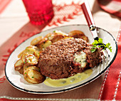 Surprise hamburger with Roquefort center, potatoes sauté with Roquefort sauce